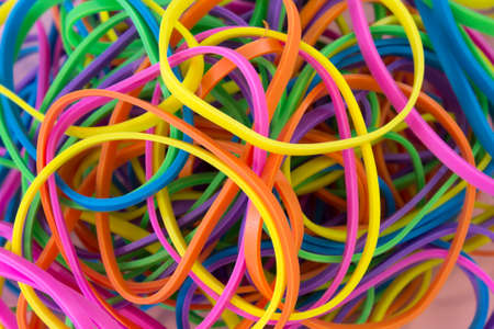 This is a photograph of a pile  Neon Colored elastic rubber bands