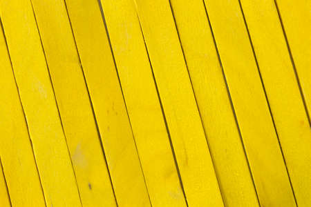 This is a photograph of Yellow colored popsicle sticks background Stock Photo