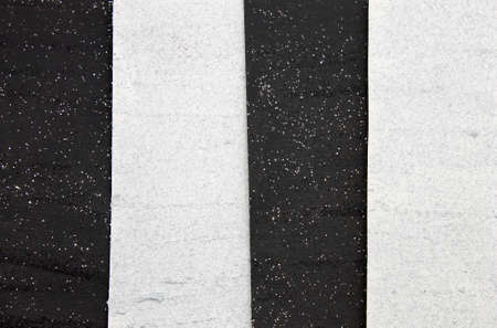 This is a photograph of a shiny textured Black and White striped background created using acrylic paint and glitter