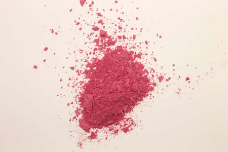 This is a photograph of Pink powder Blusher isolated on a White background