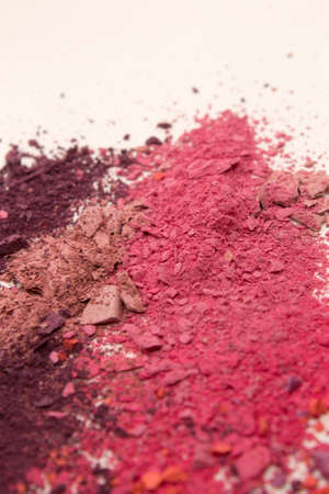 This is a photograph of colorful powder blusher isolated on a White background