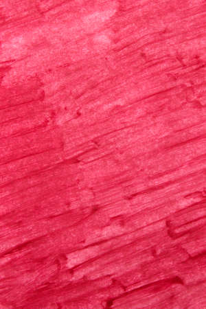This is a photograph of a Pink Lipstick swatch background