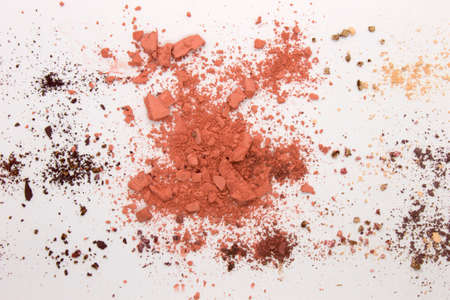 This is a photograph of peach colored Powder Eyeshadow isolated on a White Background