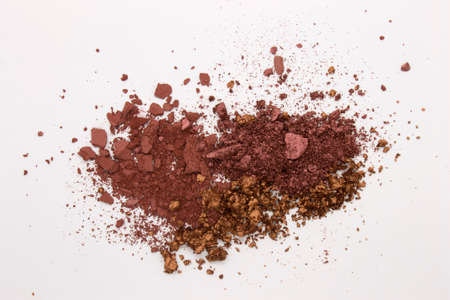 This is a photograph of a Burgundy,Metallic Bronze,and Burnt Umber Powder Eyeshadow isolated on a White Background