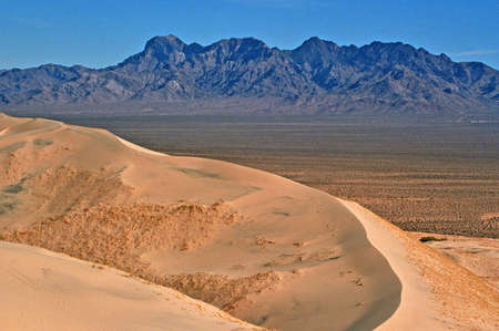 sand dunes with blue mountains