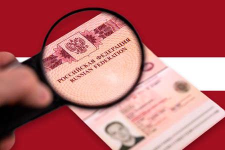 Observing Russain foreign passsport through a magnifying glass.