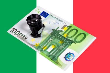 One hundred euro banknote under close investigation. Concept illustrating financial relations. 写真素材