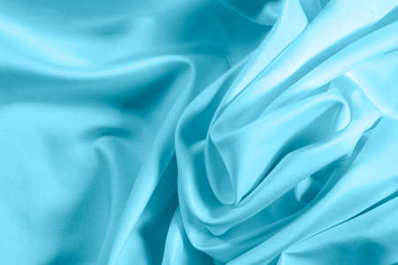 Closeup of rippled light blue satin fabric