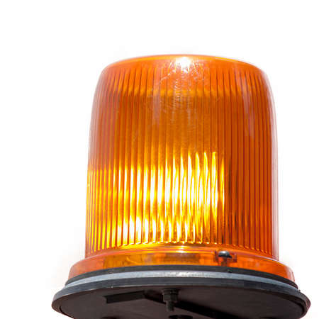 An isolated image of a yellow flashing light.