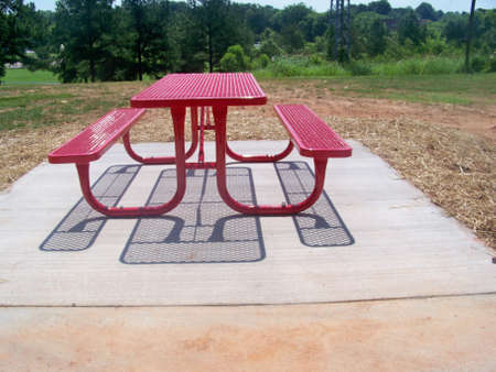 a  park  bench  outside  on  cement