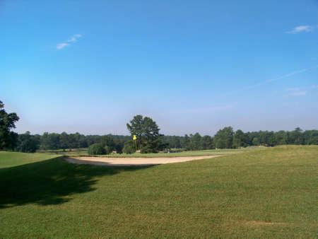 golf  hole  near  sand  bunker Stock Photo