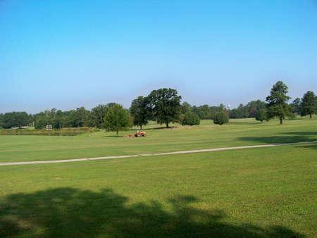 groundskeeper  cutting  grass  at  golf  course