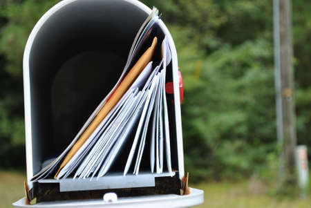 bundle of letters: mailbox  full  of  mail