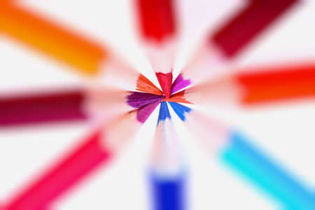 pack of colored crayons in circular display in diffused light