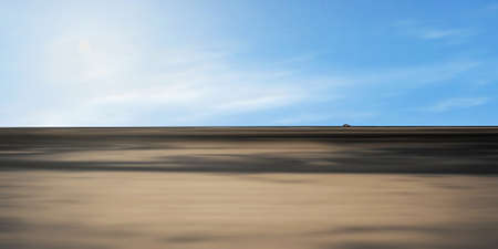 isolated road with a single car in the distance Stock Photo