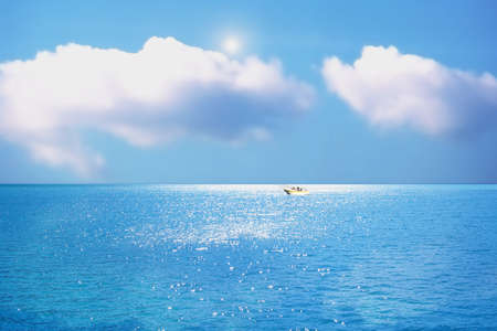 boat on the blue lake under blue sky Stock Photo