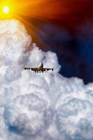 airplane over the clouds under sun rays