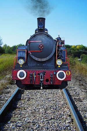 wood railways: old locomotiveon the traks with smog puff Stock Photo