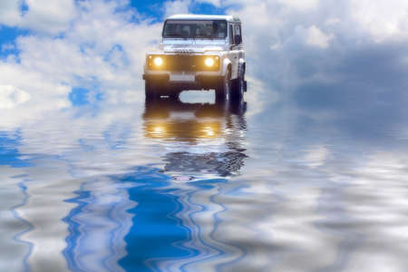 off road car driving into the water photo