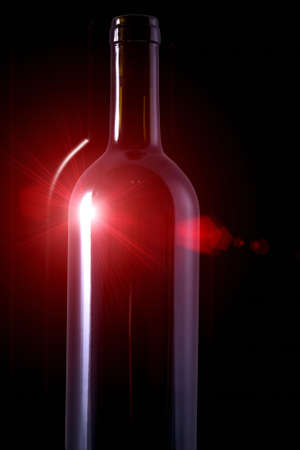 wine red bottle with rubin light reflections in the dark photo