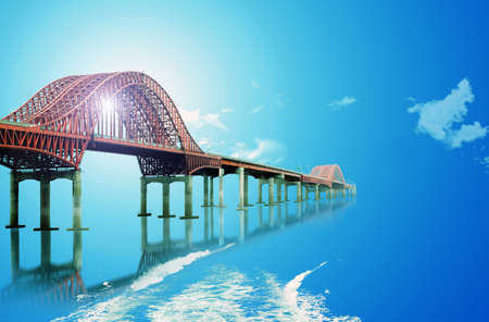 steel bridge over the blue water and sky