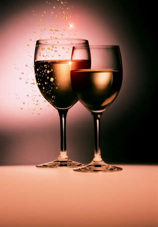 pair of golden  wine glasses with rays light reflections Stock Photo - 9012322