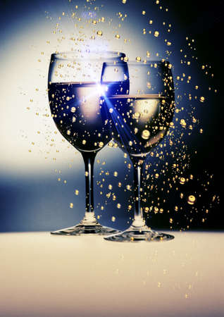 pair of golden  wine glasses with rays light reflections Stock Photo - 9037227