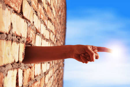 hand breaking wall to touch the sun Stock Photo - 9040850