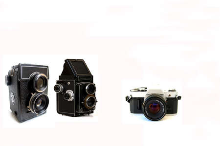 four old film cameras display on the white background Stock Photo