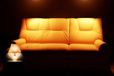 sofa with lamp in the room with lights photo