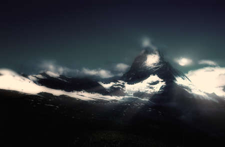 frozen moon over mountains and rays reflections Stock Photo