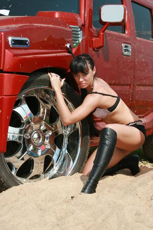The girl in bikini poses at the smart car photo