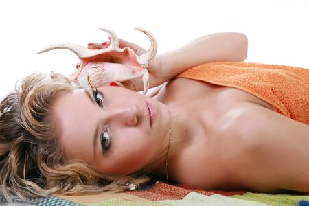 The woman with a cockleshell in a hand on cosmetic procedures Stock Photo - 4251112
