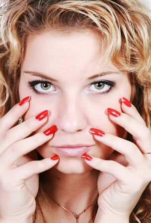 Face girls with bright eyes and red nails photo