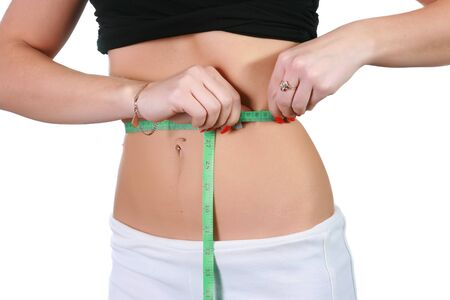 The sports girl measures volume of a waist Stock Photo - 4251030