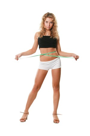 The sports attractive woman measures a waist Stock Photo - 4250891
