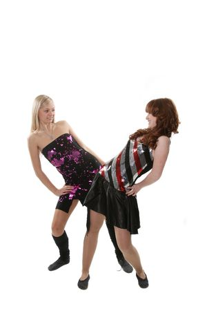 Two girls of the dancer pose in studio photo