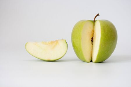 Juicy green an apple on a white background photo