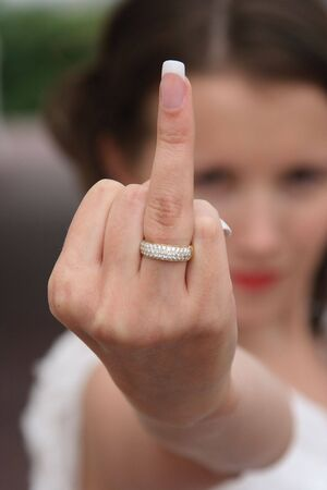 brilliants: Gold ring with brilliants on a finger at the bride