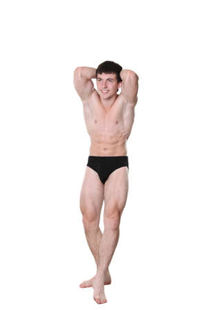 The young athlete the man poses on a white background Stock Photo - 8565931