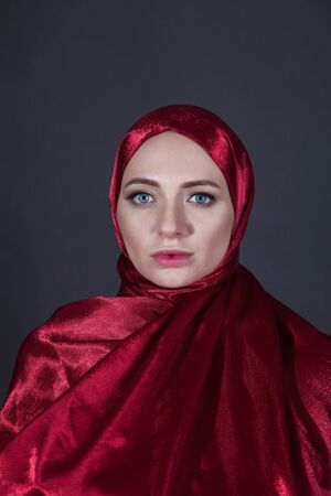 mysterious beautiful woman in the red silk dress of the Eastern Muslim peoples