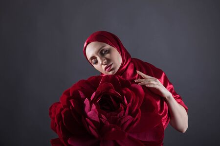 mysterious beautiful woman in the red silk dress of the Eastern Muslim peoples 스톡 콘텐츠