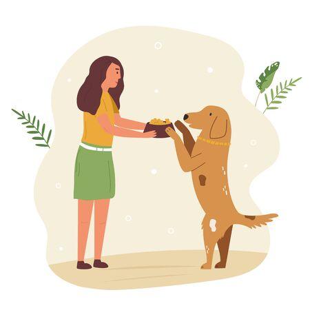Young cute volunteer girl feeding street dog