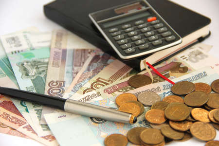 roubles: Roubles, pen, notebook and calculator Stock Photo