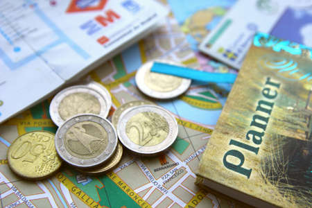 City maps, euro coins and planner