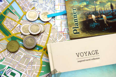 Planner, notebook, map, euro coins