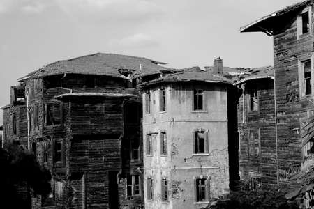 Old destroyed wooden building, black and white photo