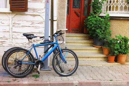Blue bike on the street Banco de Imagens - 55535713