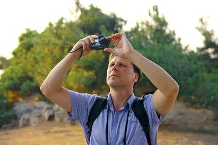 Man taking photo of birds