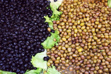 Mediterranean market. Black and green olives Banco de Imagens - 60008049